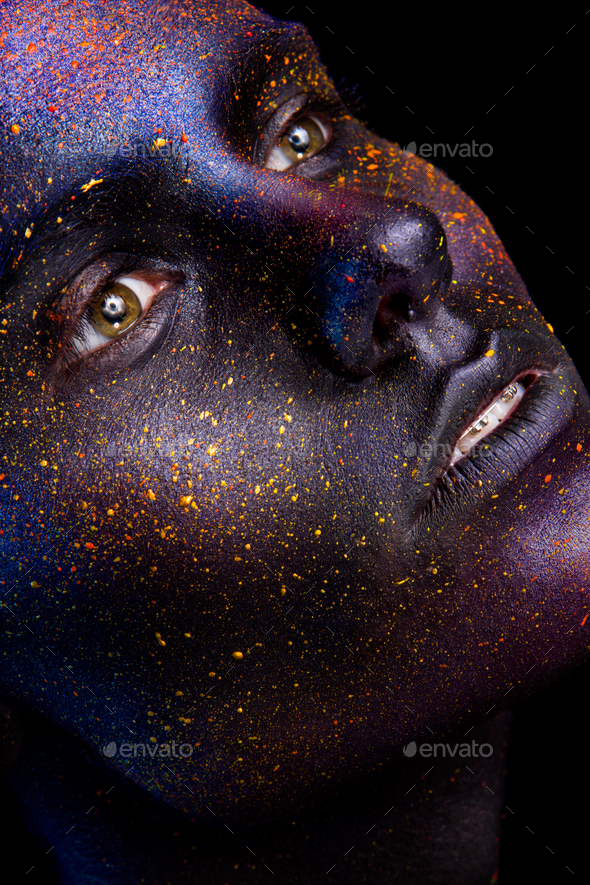 Glowing neon makeup with dramatic look in his eyes. - Stock Photo - Images
