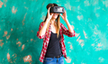 woman getting experience using VR-headset glasses of virtual reality - PhotoDune Item for Sale