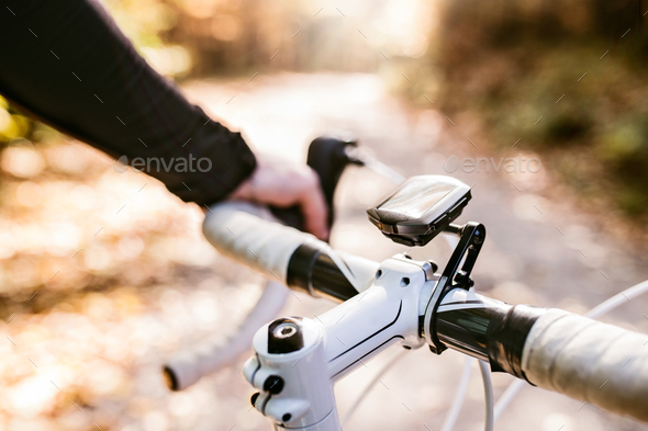 Unrecognizable sportsman riding his bicycle in sunny autumn natu - Stock Photo - Images