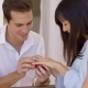 Man Fitting Ring On Finger Of Girlfriend - VideoHive Item for Sale