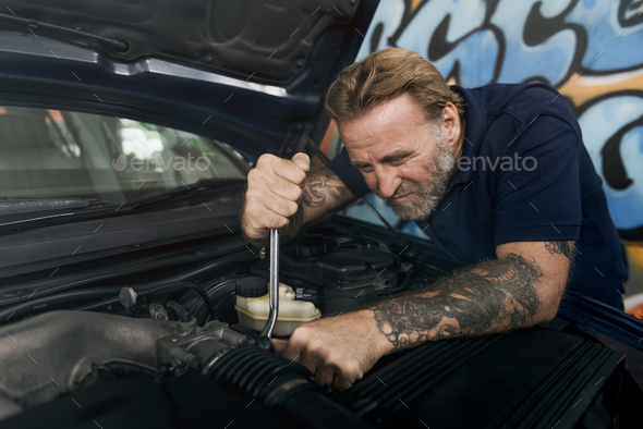 Garage Motor Maintenance Mechanic Fixing Spare Concept - Stock Photo - Images