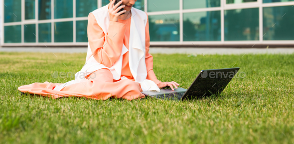 beautiful young Muslim girl sitting with notebook outdoor - Stock Photo - Images