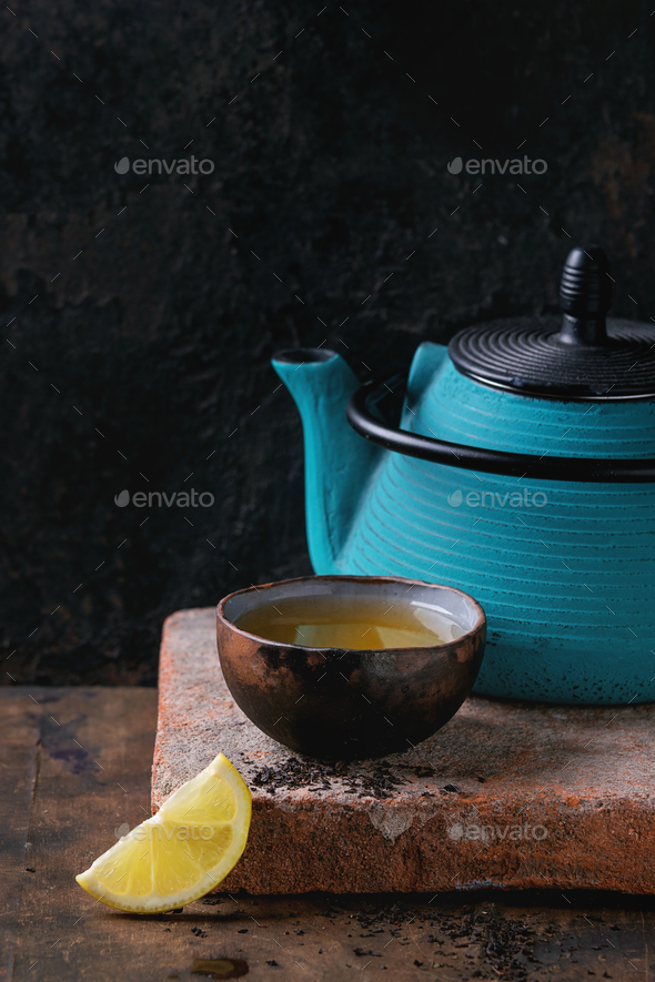 Cup of black tea with lemon - Stock Photo - Images