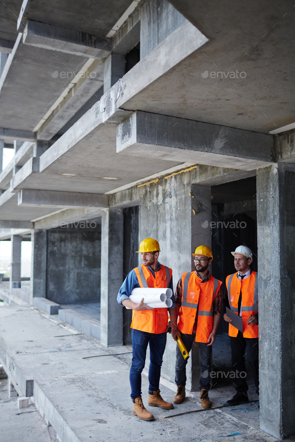 Working in unfinished building - Stock Photo - Images