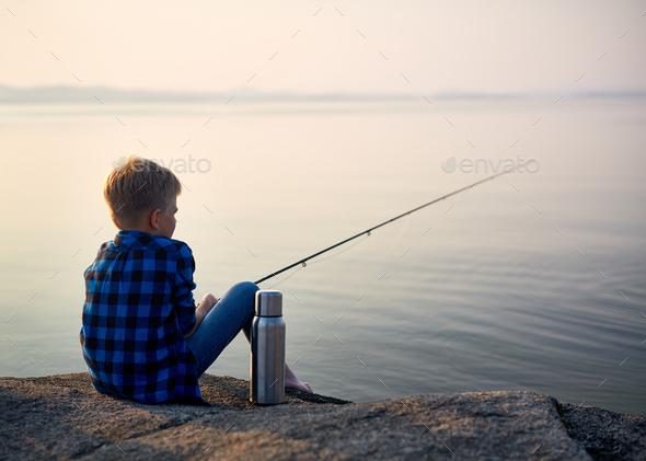 Boy fishing - Stock Photo - Images