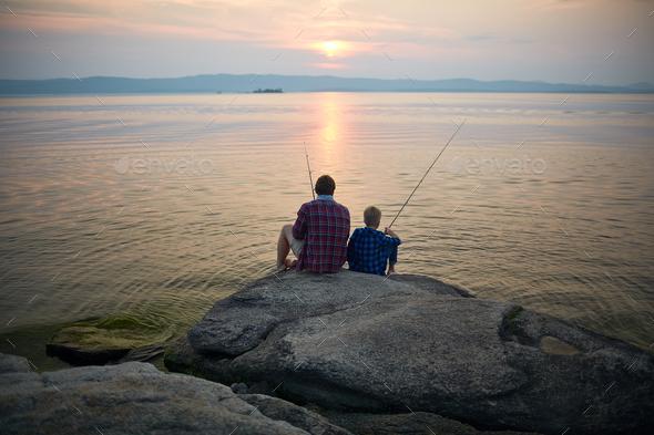Fishing on sunset - Stock Photo - Images
