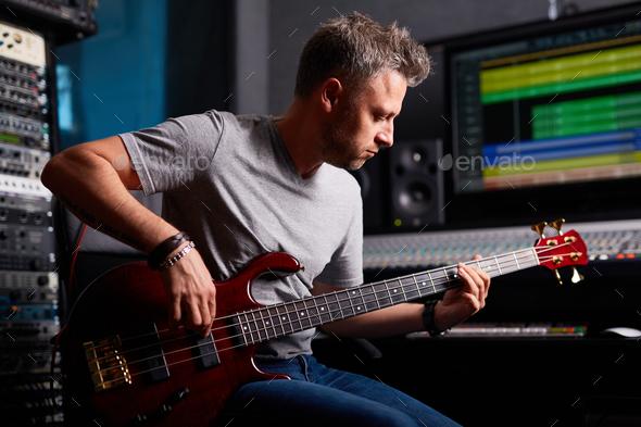 Musician in studio - Stock Photo - Images