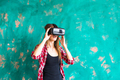 girl getting experience using VR-headset glasses of virtual reality gesticulating hands