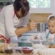 Young Mother And Daughter Baking In The Kitchen - VideoHive Item for Sale