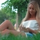 Young Attractive Girl Using Smartphone While Sitting In The Park - VideoHive Item for Sale