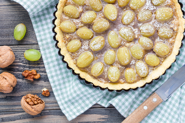 Shortbread dough grape tart with walnut praline, top view, horizontal - Stock Photo - Images