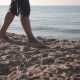 A Man Walks Along The Seashore - VideoHive Item for Sale