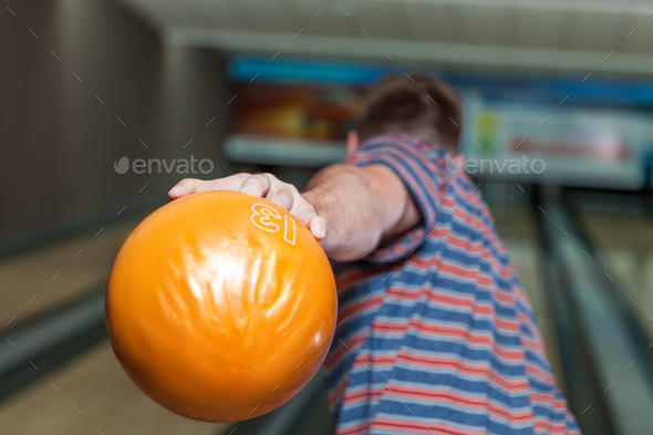 Man playing bowling - Stock Photo - Images