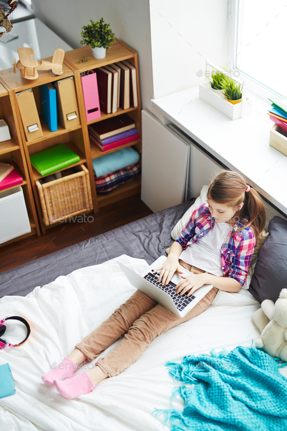 Girl with Laptop in her Room - Stock Photo - Images