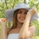 Girl Posing In a Hat Outdoors - VideoHive Item for Sale