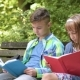 Boy And Girl Reading Book - VideoHive Item for Sale