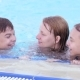 Happy Family Enjoying In Pool - VideoHive Item for Sale