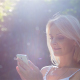 Beautiful Girl Using SmartPhone Enjoying the Sun in City Park 2 - VideoHive Item for Sale
