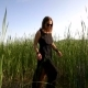 Girl In a Black Dress And Sunglasses Walking In The Field With High Grass - VideoHive Item for Sale