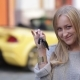 Young Smiling Woman Holding Keys To New Car - VideoHive Item for Sale