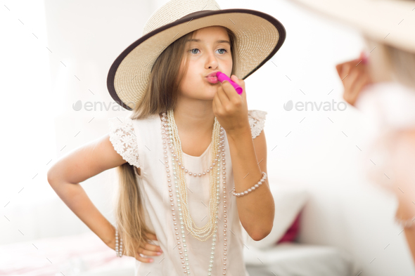 Applying lipstick - Stock Photo - Images