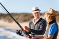 Senior man fishing with his grandson - PhotoDune Item for Sale