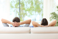 Couple relaxing on a couch at home - PhotoDune Item for Sale