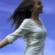 Attractive Young Woman Dancing Outdoors On a Blue Sky Background - VideoHive Item for Sale