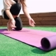 Young Woman Unfolding Mat For Yoga Practice - VideoHive Item for Sale