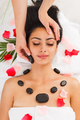 Beautician make stone massage spa for woman at wellness center - PhotoDune Item for Sale