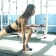 Young Woman With Sports Body Stretching - VideoHive Item for Sale