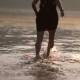Girl Runs Along The Beach Knees In Water - VideoHive Item for Sale