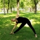 Young Woman Doing Yoga in Park - VideoHive Item for Sale