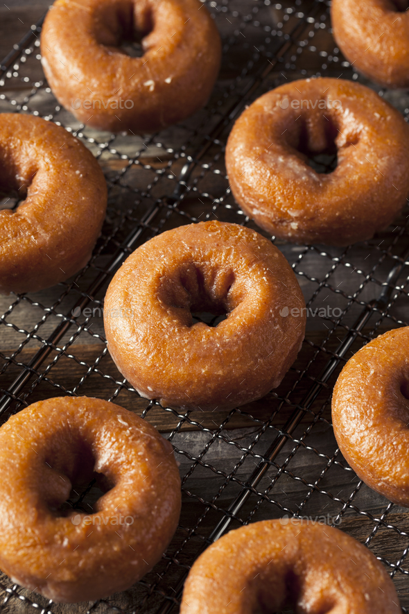 Homemade Glazed Autumn Pumpkin Donuts - Stock Photo - Images