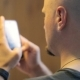 Bald Person With Beard Types Text Messages On Smartphone. - VideoHive Item for Sale