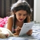 Girl Teen Playing Tablet Game Internet Sitting On Bed Next To Cat - VideoHive Item for Sale