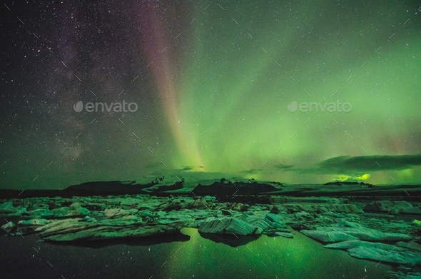 Northern lights over the ice lagoon, Iceland - Stock Photo - Images