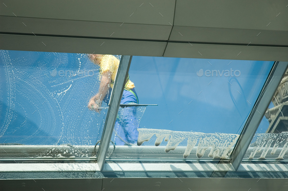 worker cleaning windows - Stock Photo - Images