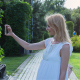 Beautiful Girl Making Selfie Enjoying the Sun in City Park 3 - VideoHive Item for Sale