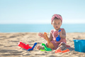 baby girl playing with beach toys at the beach - PhotoDune Item for Sale