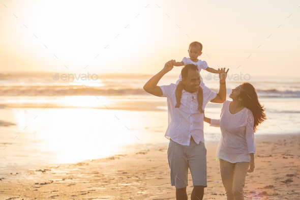 happy family and baby enjoying sunset in the summer leisure - Stock Photo - Images