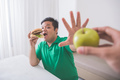 man refuse to eat healthy - PhotoDune Item for Sale