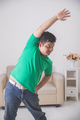 overweight man doing some exercise at home - PhotoDune Item for Sale