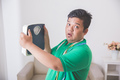 shocked obese man while looking at a weight scale - PhotoDune Item for Sale
