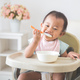 baby girl sitting on high chair and feed her self - PhotoDune Item for Sale