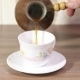 Woman Pouring Milk To Cup Of Espresso Coffee.  - VideoHive Item for Sale