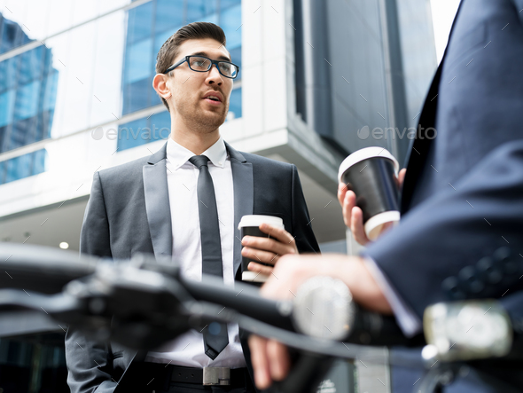 Young businessmen with a bike - Stock Photo - Images