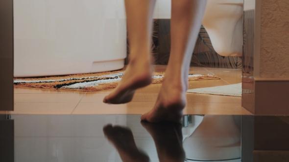 bathroom legs woman with bare legs walk into bathroom come to white bath little