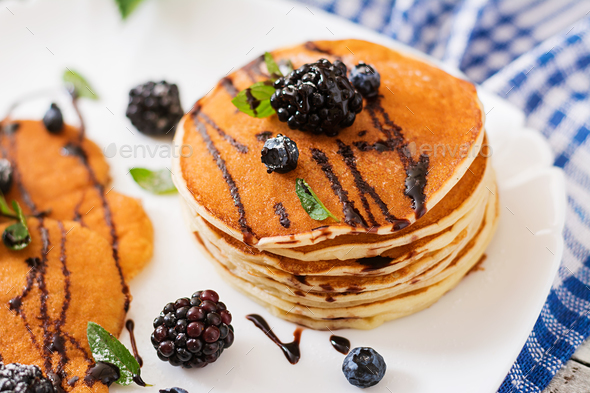 Delicious pancakes with blackberries and chocolate. - Stock Photo - Images