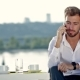 Handsome Man Talking On The Phone Outdoors - VideoHive Item for Sale